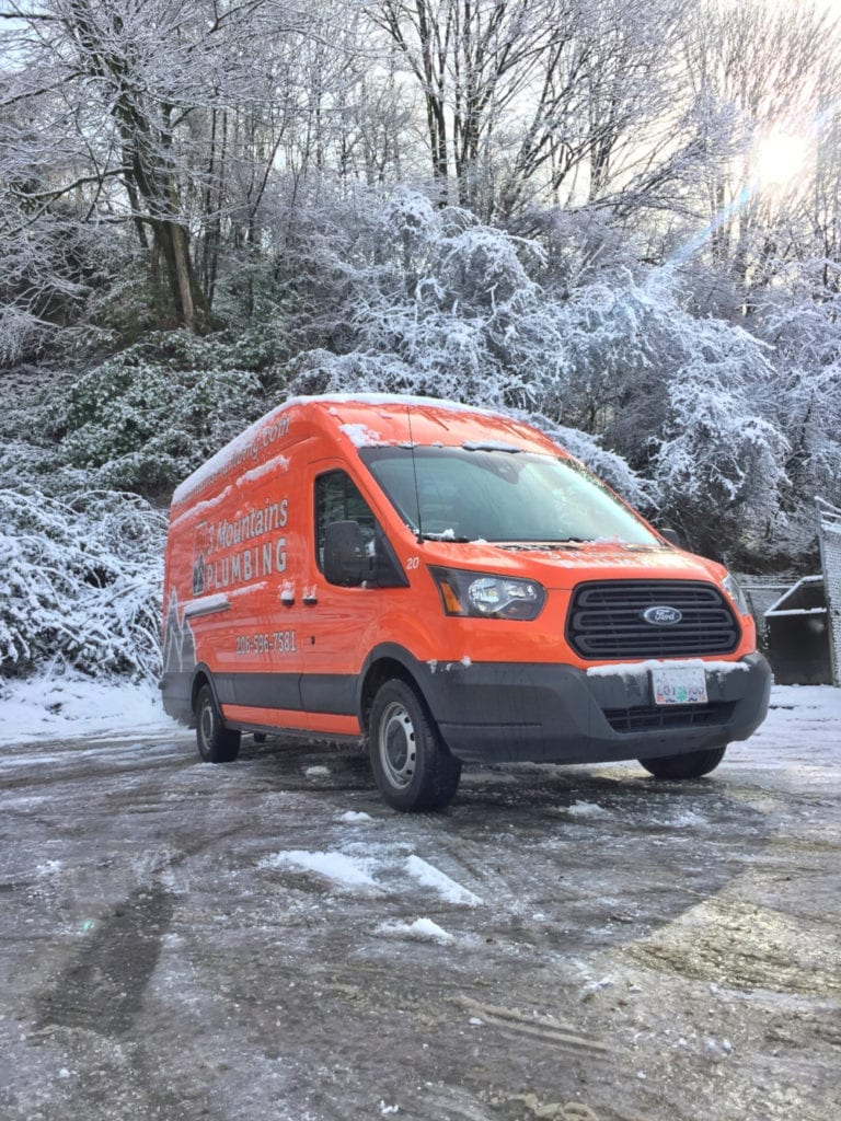 3 Mountains Plumbing truck in the snow